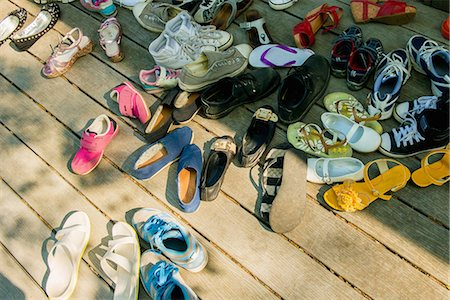 summer - Large group of shoes on wooden planks Stock Photo - Premium Royalty-Free, Code: 614-07031207