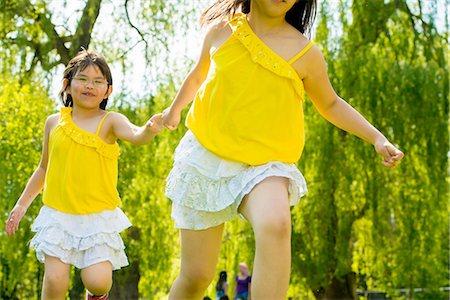 friendship - Girls holding hands Stock Photo - Premium Royalty-Free, Code: 614-07031201