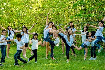 preteen dancing - Large group of children dancing in park Stock Photo - Premium Royalty-Free, Code: 614-07031216