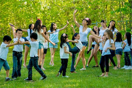 Large group of children dancing in park Stock Photo - Premium Royalty-Free, Code: 614-07031217