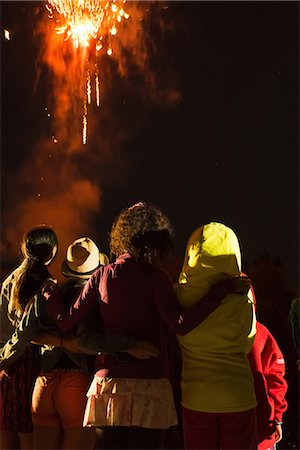 Group of people watching firework display Stock Photo - Premium Royalty-Free, Code: 614-07031244
