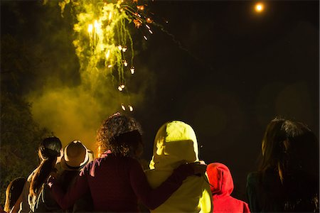 Group of people watching firework display Stock Photo - Premium Royalty-Free, Code: 614-07031245