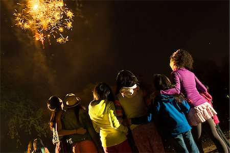 Group of people watching firework display Stock Photo - Premium Royalty-Free, Code: 614-07031246