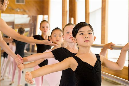 Ballerinas practising at the barre in ballet school Stock Photo - Premium Royalty-Free, Code: 614-07031251