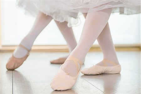 Ballerinas practising together, low section Stock Photo - Premium Royalty-Free, Code: 614-07031263