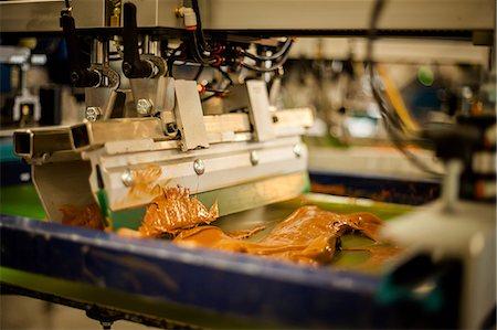 Screen print machine spreading ink on frame Stock Photo - Premium Royalty-Free, Code: 614-07031278