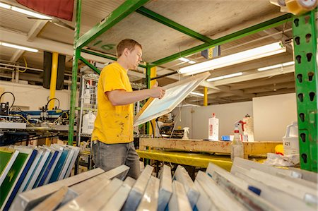 print - Worker carrying frame in screen printing workshop Stock Photo - Premium Royalty-Free, Code: 614-07031297