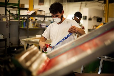 print - Worker measuring adhesive tape in screen printing workshop Stock Photo - Premium Royalty-Free, Code: 614-07031313