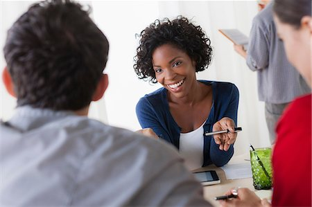Colleagues meeting in office Stock Photo - Premium Royalty-Free, Code: 614-07031376
