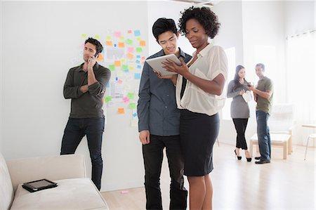 self adhesive note - Office workers looking at digital tablet Stock Photo - Premium Royalty-Free, Code: 614-07031408