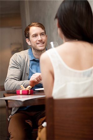 romanticism - Young couple sitting in restaurant Stock Photo - Premium Royalty-Free, Code: 614-07031511