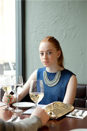 Young woman in restaurant Stock Photo - Premium Royalty-Free, Code: 614-07031524