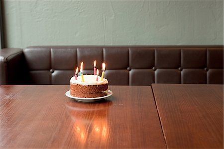 Birthday cake on table in restaurant Stock Photo - Premium Royalty-Free, Code: 614-07031568