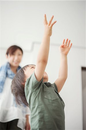 reaching - Boy reaching with arms up Stock Photo - Premium Royalty-Free, Code: 614-07031617