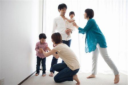 Three generation family by window Stock Photo - Premium Royalty-Free, Code: 614-07031610