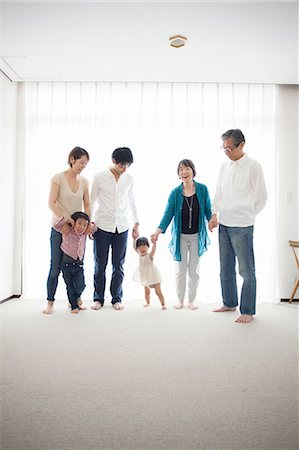 Three generation family holding hands, portrait Stock Photo - Premium Royalty-Free, Code: 614-07031611