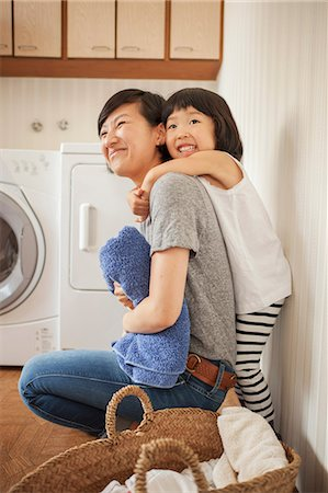 east asian - Mother and daughter in utility room Stock Photo - Premium Royalty-Free, Code: 614-07031663