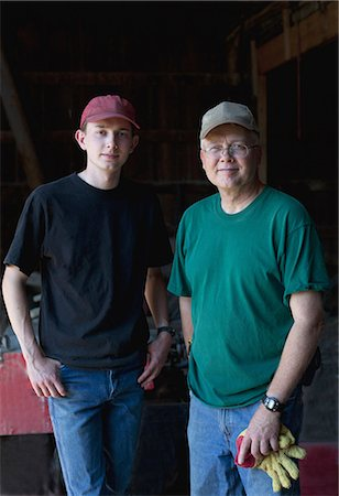 Mature farmer and son in barn, portrait Stock Photo - Premium Royalty-Free, Code: 614-07031794