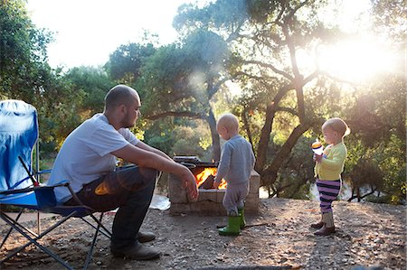 Toddler twins on camping site with father Stock Photo - Premium Royalty-Free, Code: 614-07031830