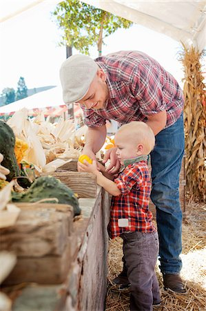 farm and boys - Young father and son looking at squashes Stock Photo - Premium Royalty-Free, Code: 614-07031846