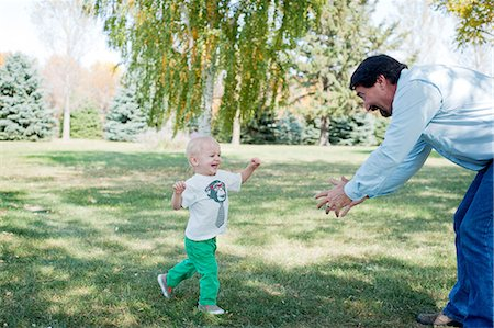 Grandfather playing with grandson in park Stock Photo - Premium Royalty-Free, Code: 614-07031841