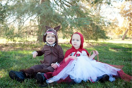 Toddler twins in woods dressed up as red riding hood and wolf Stock Photo - Premium Royalty-Free, Code: 614-07031858