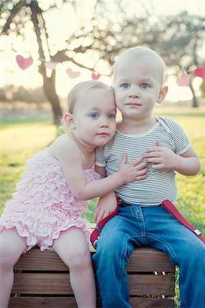 Brother and sister sitting outdoors Stock Photo - Premium Royalty-Free, Code: 614-07031872