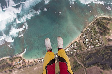 sky - Legs and feet of skydiver above coastline Stock Photo - Premium Royalty-Free, Code: 614-07031894