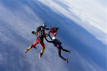sports - Small group of skydivers in formation Stock Photo - Premium Royalty-Free, Code: 614-07031896