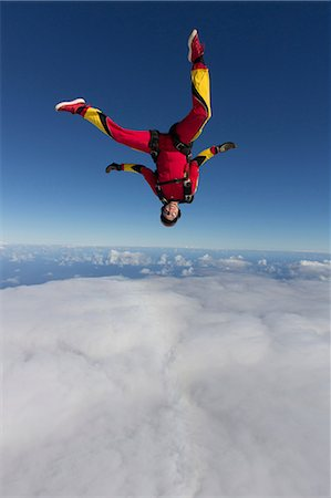 Female skydiver free falling upside down Stock Photo - Premium Royalty-Free, Code: 614-07031893