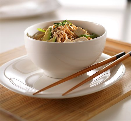 Soba noodles and tofu in white bowl Stock Photo - Premium Royalty-Free, Code: 614-07031901