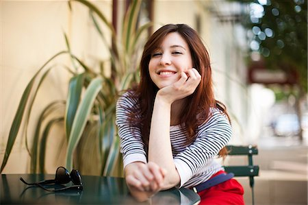 female - Portrait of young woman at sidewalk cafe Stock Photo - Premium Royalty-Free, Code: 614-07031918