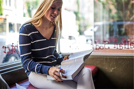 street cafe day - Teenage girl studying in cafe Stock Photo - Premium Royalty-Free, Code: 614-07031989