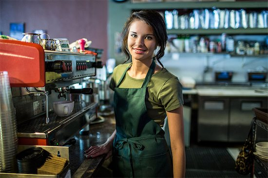 Portrait of teenage waitress in coffee house Stock Photo - Premium Royalty-Free, Image code: 614-07032008