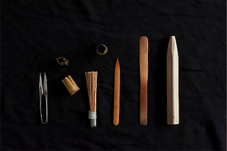 Traditional Japanese tools on black background Stock Photo - Premium Royalty-Free, Code: 614-07032055