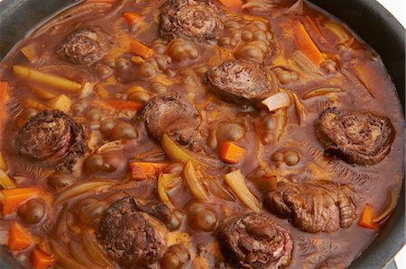 Still life of meat roulades in stew Stock Photo - Premium Royalty-Free, Code: 614-07032081