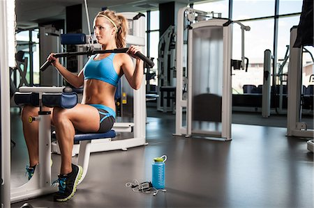 physical fitness - Woman pulling weights Stock Photo - Premium Royalty-Free, Code: 614-07032163