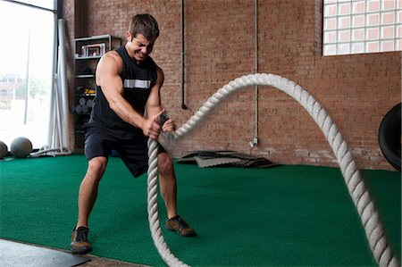 pulling - Male bodybuilder using ropes in gym Stock Photo - Premium Royalty-Free, Code: 614-07032198