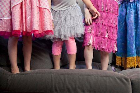 Children standing on sofa Stock Photo - Premium Royalty-Free, Code: 614-07145686