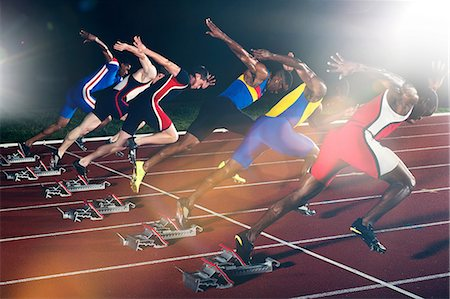 race track (people) - Six athletes starting race at night Stock Photo - Premium Royalty-Free, Code: 614-07145727