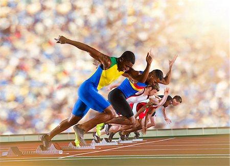 sprint - Five athletes starting a sprint race Stock Photo - Premium Royalty-Free, Code: 614-07145722