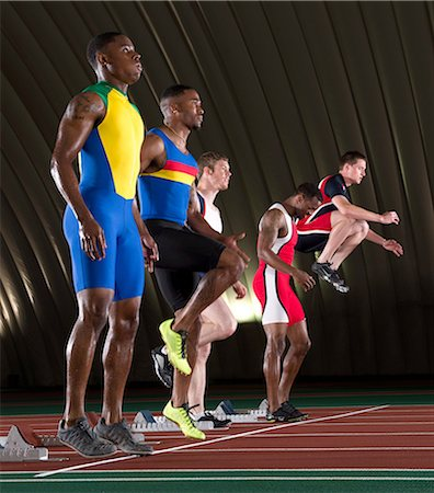 sprint - Athletes standing at start line of race Stock Photo - Premium Royalty-Free, Code: 614-07145734