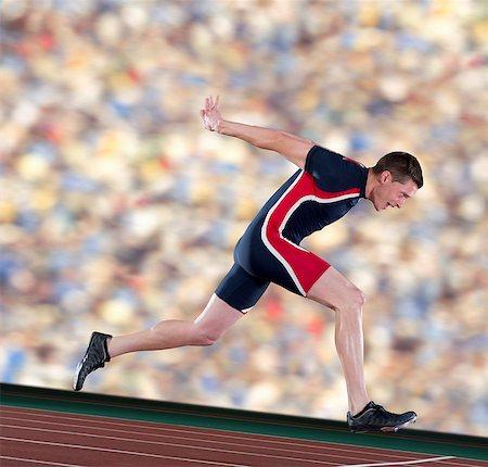 finish line - Athlete finishing race Stock Photo - Premium Royalty-Free, Code: 614-07145735