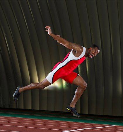 finish line - Athlete finishing race Stock Photo - Premium Royalty-Free, Code: 614-07145736