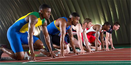 sprint - Athletes on start line of race Stock Photo - Premium Royalty-Free, Code: 614-07145732