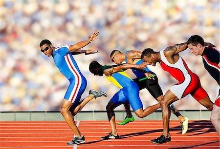 sprint - Five athletes running relay race Stock Photo - Premium Royalty-Free, Code: 614-07145745