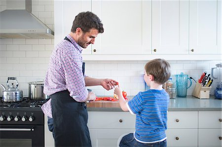 Father and son preparing food at home Stock Photo - Premium Royalty-Free, Code: 614-07145902