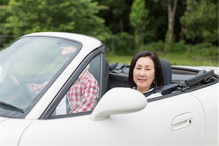 Couple enjoying leisurely drive in sports car Stock Photo - Premium Royalty-Free, Code: 614-07145936