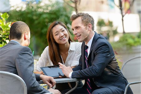 Business people chatting at coffee break Stock Photo - Premium Royalty-Free, Code: 614-07145986