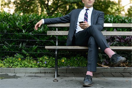 people sitting on bench - Businessman relaxing on bench Stock Photo - Premium Royalty-Free, Code: 614-07146015